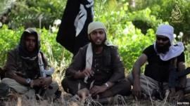 Islamist fighter identified as Nasser Muthan, centre, from Britain