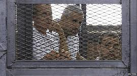 Peter Greste (left), Mohamed Fahmy (centre) and Baher Mohamed