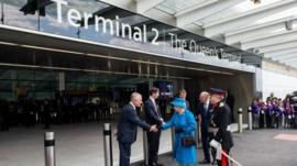 Queen Elizabeth II and Prince Philip, Duke of Edinburgh are greeted by Nigel Rudd, Chairman of London Heathrow, John Holland-Kaye Heathrow Development Director and Colin Matthews,