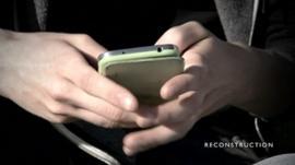 Boy holding phone
