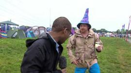 The BBC's Lizo Mzimba talks with a Glastonbury reveller