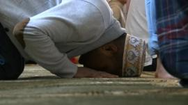 A man bows his head in prayer