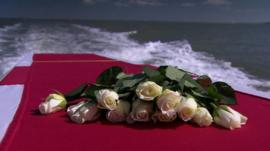 Roses placed on top of a coffin