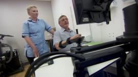 Nurse and stroke patient with robot