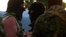 Ukraine rebels in combat gear and balaclavas