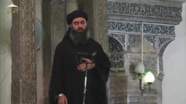 Still from Isis video of Abu Bakr al-Baghdadi in a mosque