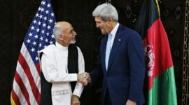 John Kerry shakes hands with Afghanistan presidential candidate Ashraf Ghani