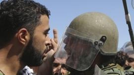 Palestinian protester and Israeli soldier