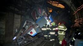 emergency workers at scene of derailment