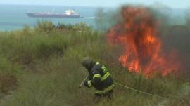 Firefighter tackles flames after rocket strike