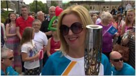 Clare Grogan carries the Queen's baton in Johnstone
