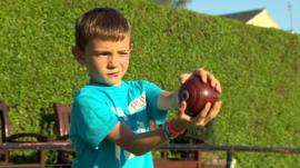 Josh, 6 throwing a bowl