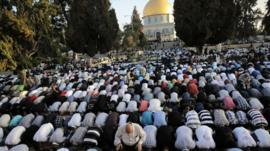 Muslim worshippers take part in a prayer in front of the Dome of the Rock during the holiday of Eid al-Fitr on the compound known to Muslims as al-Haram al-Sharif and to Jews as Temple Mount in Jerusalem