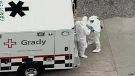 Kent Brantly, dressed in protective clothing, arriving at Emory University Hospital