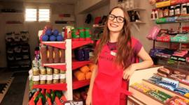Lucy Sparrow in her corner shop selling felt goods
