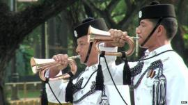 Two Singapore Army trumpeters play at tribute to start of WW1