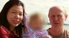 Wendy and David Farnell, with surrogate daughter (blurred)