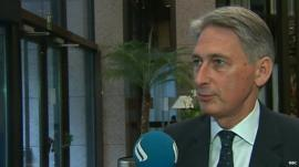 Foreign Secretary Philip Hammond speaking from Brussels