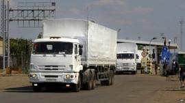 First trucks pass the border post at Izvaryne, eastern Ukraine