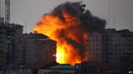 Ball of fire rises from a building following an Israeli air strike in Gaza City on August 23