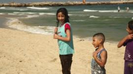 Children on a beach in Gaza