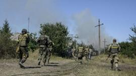 Ukrainian servicemen seen during fighting with pro-Russian separatists in the eastern Ukrainian town of Ilovaysk