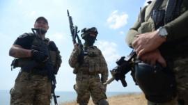 Ukrainian troops on hills above Mariupol