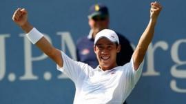 Kei Nishikori celebrates after defeating Novak Djokovic of Serbia in their men's singles semi final, New York, 6 September 2014
