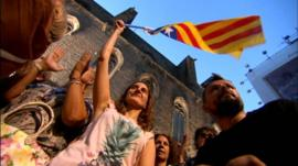 Pro-Independents fly a Catalan flag
