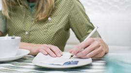 woman signing check