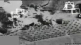 Black and white footage showing air strike on Kobane
