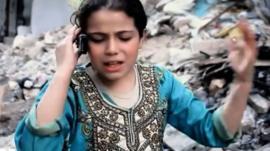 Nine-year old Rasha talking on a phone in