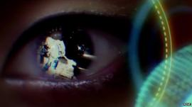 Still from Fove demo video, showing reflection of an astronaut in a human eye