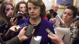 Dianne Feinstein surrounded by reporters