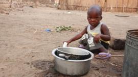 Boy in Malawi village (c) Victoria Gill
