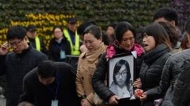 Family members mourn for the victims of a stampede