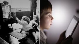 Black and white picture of children watching television / child looking at tablet computer