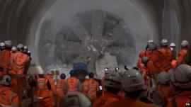 Workmen look on as tunnel machine, named Elizabeth after the Queen, to break through into the east end of Crossrail