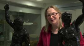 Dr Victoria Avery with statues