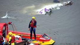 Rescuers near the plane wreckage