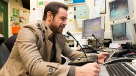Danny Dyer speaking into a microphone