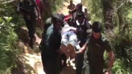 Mamitho Lendas being carried on a stretcher