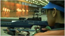 Sports star with gun