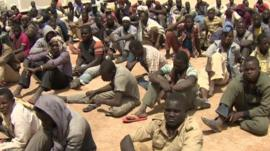 Men at migrant detention centre