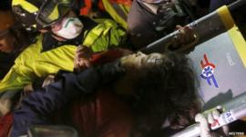 Earthquake survivor Krishna Kumari Khadka on a stretcher after being rescued from collapsed building in Kathmandu