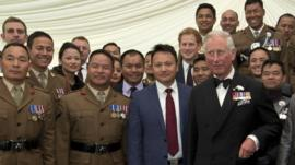 Princes Charles and Harry with a group of soldiers from the Brigade of Gurkhas