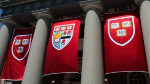 'Harvard flags' from the web at 'http://ichef-1.bbci.co.uk/news/304/cpsprodpb/11421/production/_86598607_harvardflags.jpg'