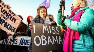 Woman holding a sign in London saying 'I miss Obama' - 21 January 2017