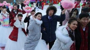 Newly wed couples attend a mass wedding ceremony at the 33rd Harbin International Ice and Snow Festival in Harbin, China's northern Heilongjiang province, 06 January 2017.
