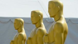 'Oscar statues in a row' from the web at 'http://ichef-1.bbci.co.uk/news/304/cpsprodpb/13244/production/_88440487_gettyimages-511884366.jpg'